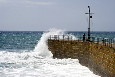 Surf on Porthleven harbour wall, Cornwall, Great Britain, Europe