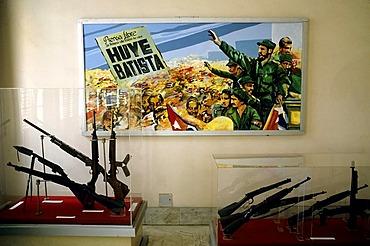 Picture of the revolution with Fidel Castro, guns in show cases, Museo de la Revolucion, Centro Habana, Havana, Cuba, Caribbean