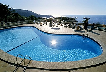 Pool with a reflection of the sun, view towards the sea, Hotel Costa d'Or, Deia, Serra de Tramuntana, Majorca, Balearic Islands, Spain, Europe
