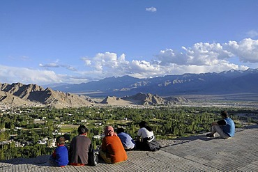 Overlooking the oasis Leh into the Indus Valley, in the foreground Ladakhi people, Ladakh, Northern India, the Himalayas