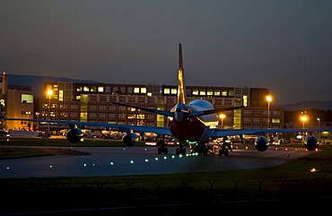 Boeing 747 being towed over the taxiway, evening light