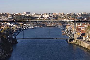 View from Maria Pia Bridge to Porto with River Rio Duoro, at the back Porte de Luis Bridge, Porto, UNESCO World Heritage Site, Portugal, Europe