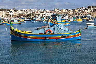 Traditional Maltese fishing boats, called Luzzu, port of Marsaxlokk, Malta, Europe