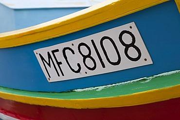 Registration number, traditional fishing boat, called Luzzu, port of Marsaxlokk, Malta, Europe