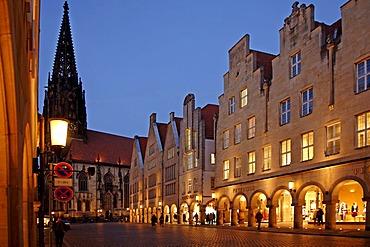 Illuminated shopping street with St. Lamberti Church, Muenster, Westphalia, Germany, Europe
