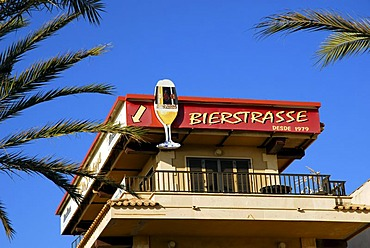Bierstrasse 1979, palm trees and a balcony with an advertisment for beer, Platja de Palma, playa, Majorca, Balearic Islands, Spain, Europe