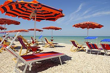 Sun umbrellas and deckchairs on the beach of Pineto, Abruzzi, Europe