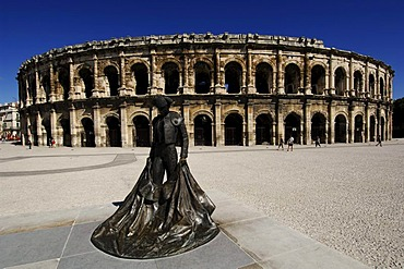 Bronze statue of the bull fighter Christian Montcouquiol, El Nimeno II, in front of the Arena, the Nimes Antique Theater, Provence, France, Europe