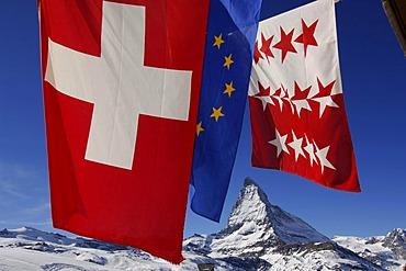 Swiss and European Flags on the Riffelberg Mountain Hut, at back the Matterhorn, Zermatt, Wallis or Valais, Switzerland, Europe