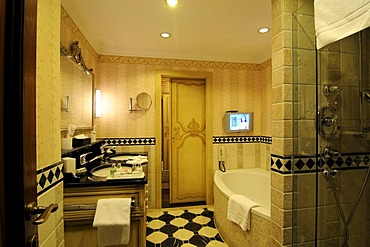 Bathroom with flatscreen monitor in Gstaad Palace Hotel, Gstaad, Western Alps, Bernese Oberland, Switzerland, Europe
