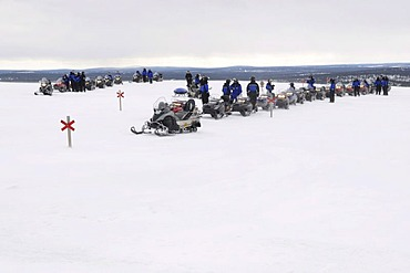 Snowmobile on a tour in the Saariselkae skiing area, Ivalo, Lapland, Finland, Europe