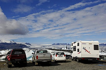 Parking area with campervan and cars at glacial lake, icebergs, glacier, Joekulsarlon, Iceland, Europe