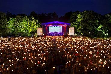 Public with sparklers, Klassik Open Air, Nuremburg Symphony Orchestra, illuminated stage, Luidpoldhain, Nuremberg, Middle Franconia, Bavaria, Germany, Europe