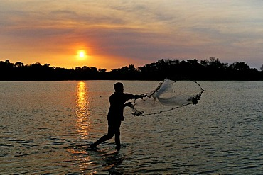 Angler at sunset, Janie Creek, Cape York Peninsula, Queensland, Australia
