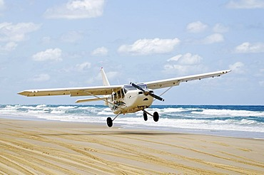 Plane landing on 75-Mile Beach, Fraser Island, Queensland, Australia