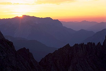 Sunset above the Karwendel Mountains seen from Mt. Hafelekar, North Tyrol, Austria, Europe