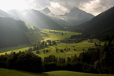 Atmospheric mood through clouds and sun rays in Pragser Valley, Alto Adige, Italy, Europe