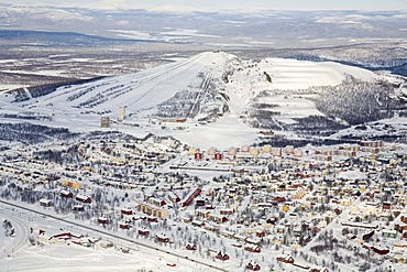 Aerial photograph of the city of Kiruna with the adjacent skiing area of Mount Luossavaara, Lappland, North Sweden, Sweden