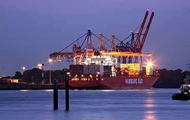 Containers being loaded on a ship in the port of Hamburg, Germany, Europe