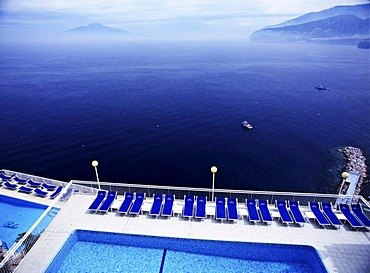 Swimming pool in Sorrent, in the gulf of Naples, Vesuv Volcano on the horizon, Italy, Europe