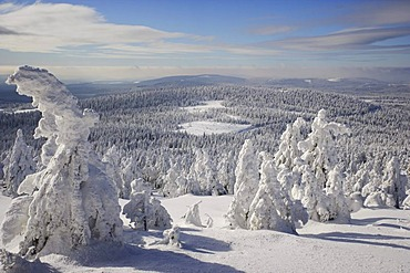 View from the Brocken mountain over a winter landscape deeply covered in snow, Saxony-Anhalt, Germany