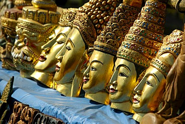 Souvenirs, row of gold painted masks carved out of wood, Indein, Inle Lake, Shan State, Burma, Myanmar, Southeast Asia
