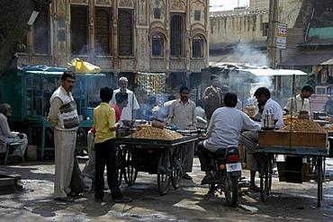 Street scene, men standing around smokey food stands, Lachmangarh, Rajasthan, India, Asia
