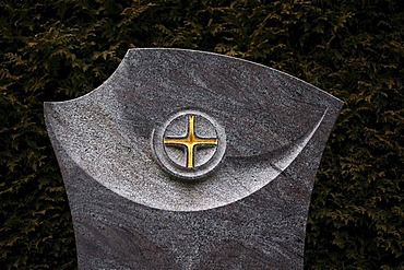 Masonry art work, cross on a gravestone