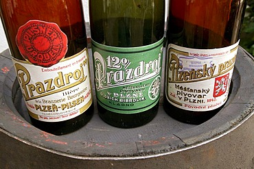 Old beer bottles of the Pilsner Brewery for the beer Pilsner Urquell, Pilsen, Plzen, Bohemia, Czech Republic, Europe.