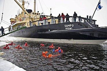 People swimming in the polar sea, Sampo icebreaker, Kemi, Lapland, Finland, Europe