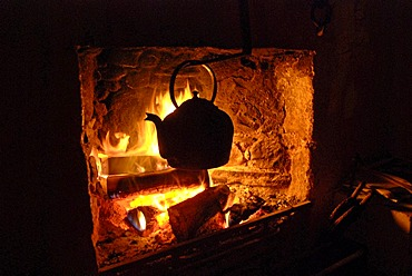 Kettle in an open fireplace in a historical cottage in the Grampians, Scotland, Great Britain, Europe