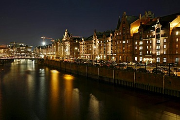 View from the Holzbruecke bridge to the old buildings in the Speicherstadt historical warehouse district, Hamburg, Germany
