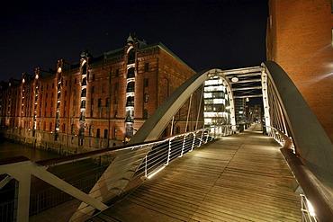 Speicherstadt historical warehouse district at night with the Sandbruecke bridge, Auf dem Sande, Hamburg, Germany