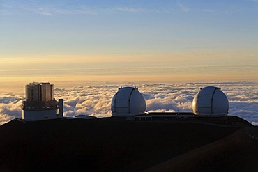 Domes of the Subaru Telescope and the two Keck Telescopes near the summit of the extinct volcano Mauna Kea, Hawaii, USA