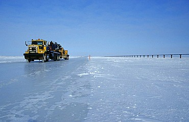 Truck driving on an ice road, built by oil companies and used to connect individual oil drilling sites in winter, Prudhoe Bay, Alaska, USA
