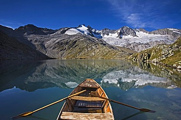 Boat in the lower Gerlossee lake, in front of Reichenspitze peak, Zillertal Alps, North Tyrol, Austria, Europe