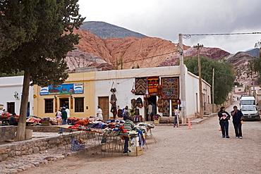 Mart in Purmamarca at the multicolored hill Cerro de los Siete Colores, Quebrada de Humahuaca, Argentina, South America