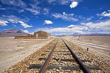 Rails with a ruin, Altiplano, Bolivia, South America