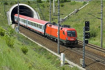 An Austrian Federal Railways passenger train on the western railway line near St. Poelten in Lower Austria, Austria, Europe