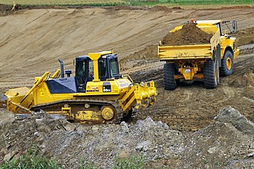 Crawler-type vehicle and truck on a building site