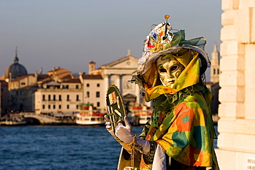Mask in evening light at the carnival, Venice, Italy