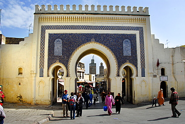 People walk through the beautiful oriental gate into the city center, Bab Bou Jeloud, Fes El-Bali Morocco