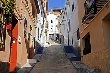Steep uphill alley in the historic centre of Callosa d'en Sarria, Alicante, Costa Blanca, Spain