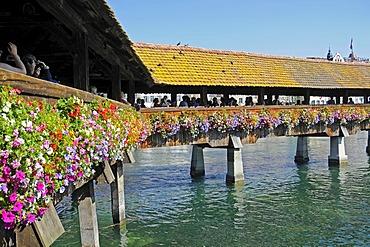 Kapellbruecke, Chapel Bridge, people, flowers, Reuss River, Lucerne, Switzerland, Europe
