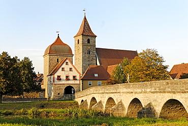 Ornbau Middle Franconia Bavaria Germany bridge across the river Altmuehl town gate and parish church St Jakobus
