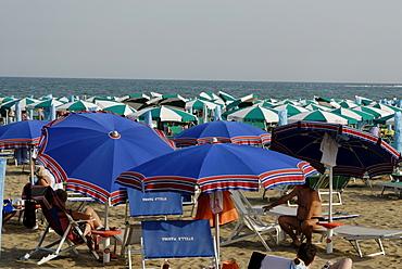 Lotᄡs of parasol sunshades at the adriatic coast near Caorle Veneto Italy