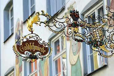 Sign of the restaurant Goldschmiede, Wasserburg, Bavaria, Germany