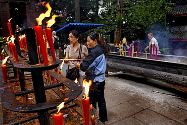 Votive candles and incenses, Wannian monastery, Mount Emei near Chengdu, China, Asia