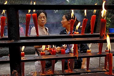 Votive candles, Wannian monastery, Mount Emei near Chengdu, China, Asia