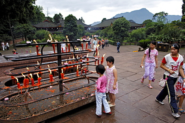 Children give votive candles, Wannian monastery, Mount Emei near Chengdu, China, Asia